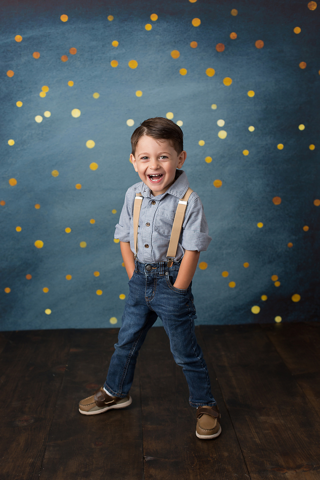 Happy three year old posing for birthday portraits.