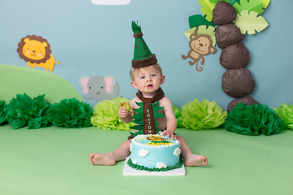 Jungle themed cake smash session by Colorado Springs photographer K.D. Elise Photography.