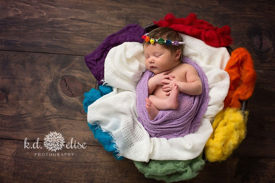 Pinimage rainbow baby surrounded by rainbow fluff by colorado springs newborn photographer k d elise photography
