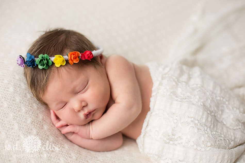 Rainbow baby girl with floral halo by Colorado Springs newborn photographer K.D. Elise Photography.