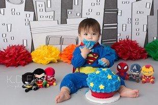 Superhero themed cake smash session by Pueblo photographer K.D. Elise Photography.