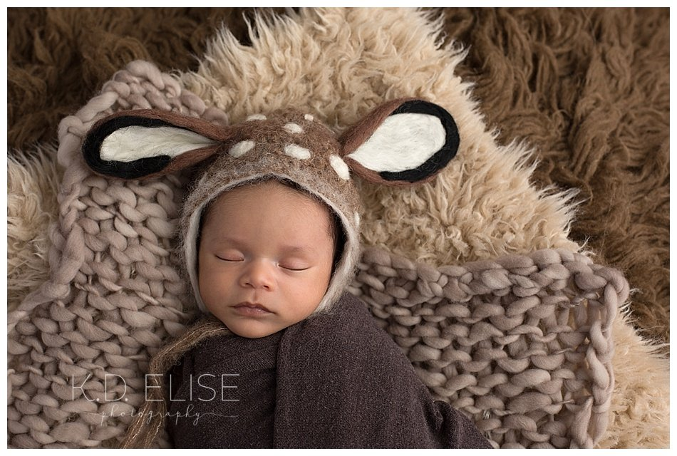 Newborn baby boy in a deer bonnet. Newborn portraits by Pueblo and Colorado Springs newborn photographer K.D. Elise Photography.
