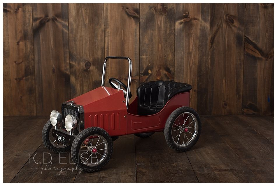 Red pedal car by Colorado Springs photographer K.D. Elise Photography
